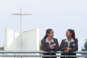 Two Mary MacKillop Catholic College Wakeley students chatting on walkway