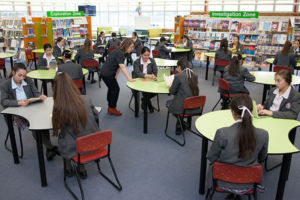 Mary MacKillop Catholic College Wakeley students reading books in school library