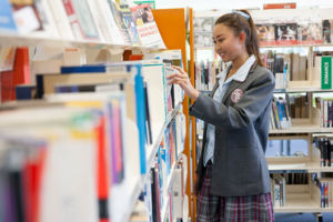 Mary MacKillop Catholic College Wakeley student choosing book inside school library
