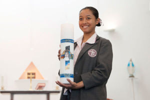 Mary MacKillop Catholic College Wakeley student holding school candle