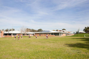 Mary MacKillop Catholic College Wakeley students enjoying green field on school grounds