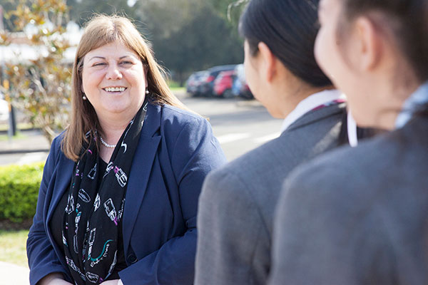 Mary MacKillop Catholic College Wakeley principal Gilda Pussich talking with students