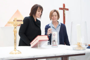 Staff lighting school candle inside chapel at Mary MacKillop Catholic College Wakeley