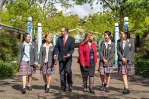 Mary MacKillop Catholic College Wakeley leadership team and student leaders walking and talking