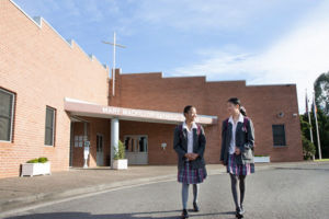 Mary MacKillop Catholic College Wakeley students walking in front of college